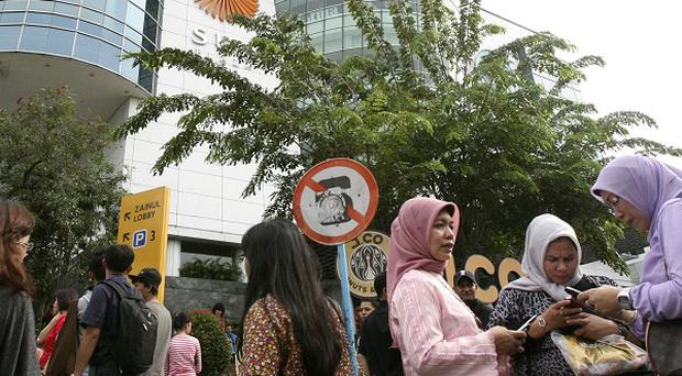 People are evacuated from a shopping mall after a strong earthquake was felt in Medan, Sumatra island, Indonesia (AP)