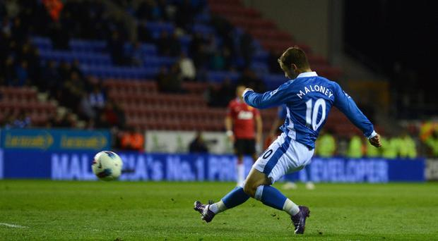 WIGAN, ENGLAND - APRIL 11: Shaun Maloney of Wigan scores to make it 1-0 during the Barclays Premier League match between Wigan Athletic and Manchester United at the DW Stadium on April 11, 2012 in Wigan, England. (Photo by Michael Regan/Getty Images)