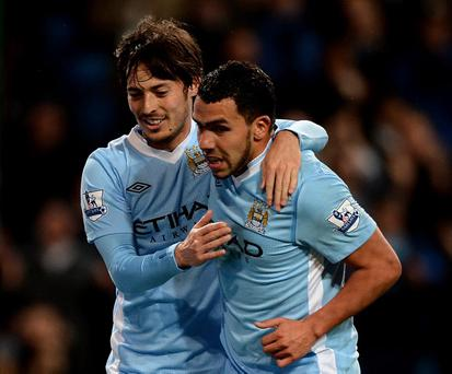 MANCHESTER, ENGLAND - APRIL 11: Carlos Tevez of Manchester City celebrates scoring his team's third goal with team mate David Silva (L) during the Barclays Premier League match between Manchester City and West Bromwich Albion at the Etihad Stadium on April 11, 2012 in Manchester, England. (Photo by Laurence Griffiths/Getty Images)