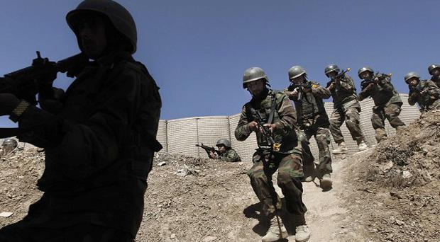 Afghan National Army commandos practice a house clearing during a training session at Camp Morehead on the outskirts of Kabul (AP)