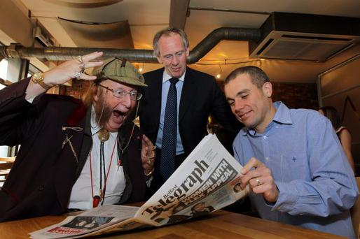 You read it here first: Top racing pundit John McCririck (left) reveals the winner of Saturday's Grand National to McLean Bookmakers chief Paul McLean |(centre) and the Belfast Telegraph's Frank Brownlow at Nick's Warehouse in Belfast yesterday