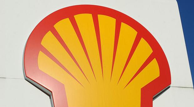 Shares in Royal Dutch Shell fell by five per cent after fears were raised of an 'oil sheen' in the Gulf of Mexico