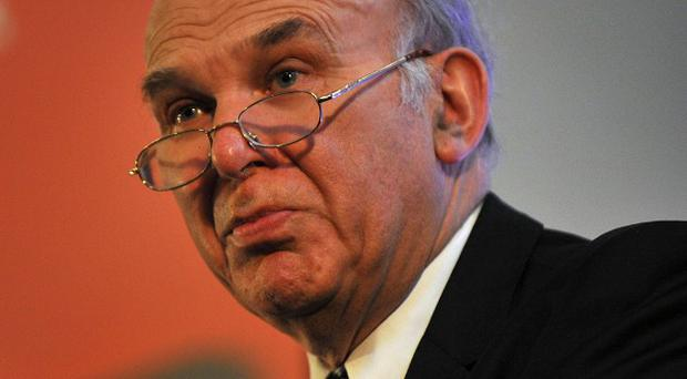 Vince Cable has said he is 'sympathetic' to concerns raised by universities over the cap on tax relief for charitable donations