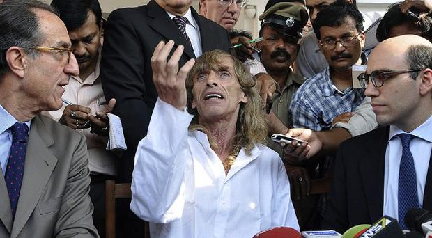 Italian tourist guide Paulo Bosusco, centre, who was abducted by Maoist rebels more than a month ago, talks to the media (AP Photo)