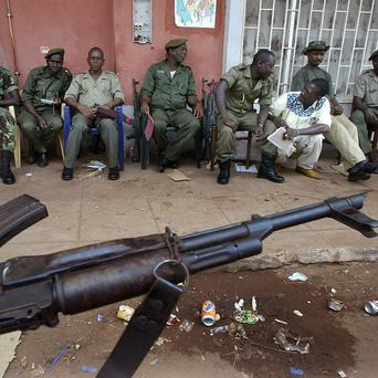 Troops sit in front of the electoral commission offices as they guard ballot boxes in Bissau, Guinea-Bissau(AP/Schalk van Zuydam)