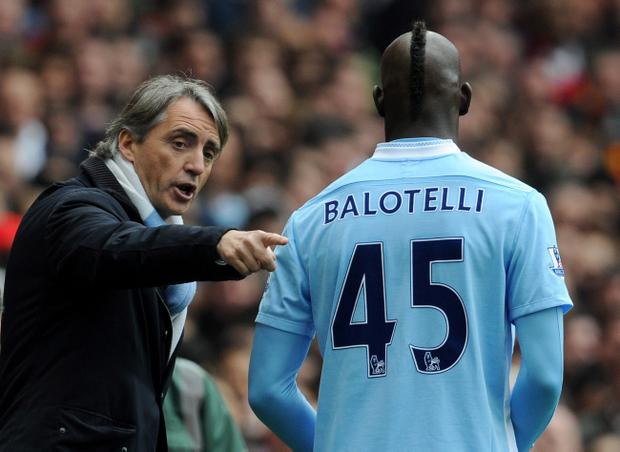 Manchester City manager Roberto Mancini (left) was angry after striker Mario Balotelli was shown a red card during the team's 1-0 defeat at Arsenal last Sunday