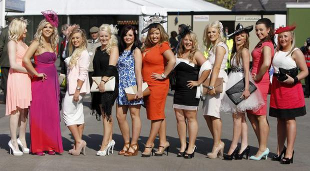 Punters arrive for Ladies Day on day two of the 2012 John Smith's Grand National meeting at Aintree Racecourse, Liverpool. PRESS ASSOCIATION Photo. Picture date: Friday April 13, 2012. See PA story RACING Aintree. Photo credit should read: Peter Byrne/PA Wire