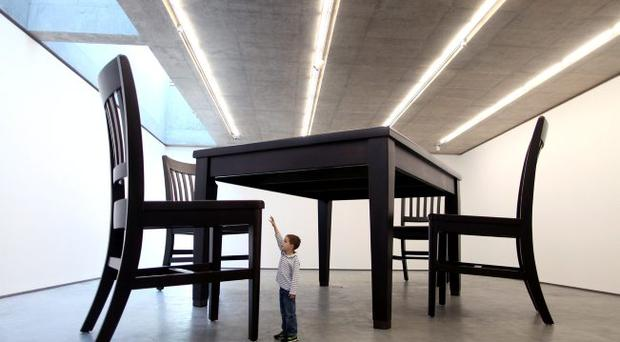 Michael Quinn (5) looks at a huge sculpture currently on display in the MAC building