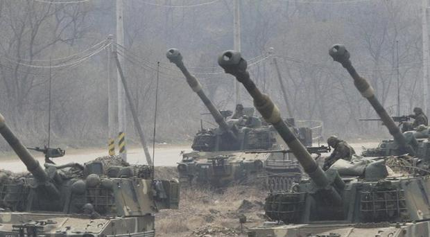 South Korean howitzers are deployed during a military exercise near the border village of Panmunjom (AP)