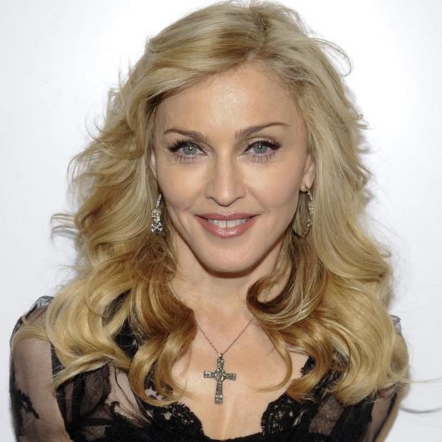 Madonna was at Macy's in New York to launch her new fragrance Truth Or Dare