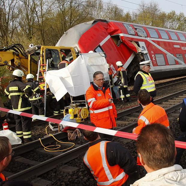 Emergency personnel help at the site of a collision between a train and a construction vehicle near Frankfurt in Germany (AP)