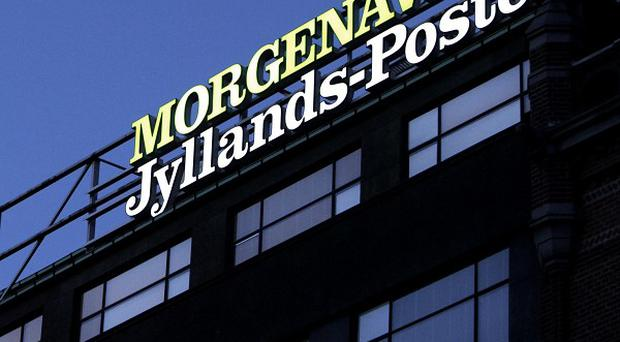 Four men have gone on trial for allegedly plotting a shooting attack on the Jyllands-Posten newspaper over cartoons of the Prophet Mohammed (AP)