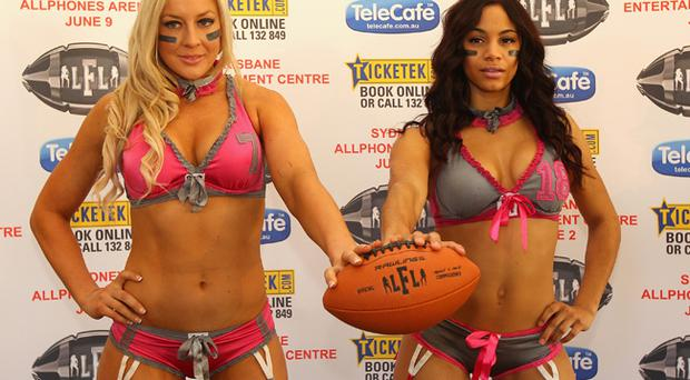 Adrian Purnell of Tampa Breeze and Chloe Butler of LA Temptation pose during a press conference for the Australian 2012 LFL All-Fantasy Game tour in Sydney, Australia. The ladies of the lingerie football league all-stars from America will play two games of gridiron in Brisbane and Sydney in June