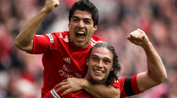 LONDON, ENGLAND - APRIL 14: Andy Carroll of Liverpool celebrates with Luis Suarez as he scores their second goal during the FA Cup with Budweiser Semi Final match between Liverpool and Everton at Wembley Stadium on April 14, 2012 in London, England. (Photo by Scott Heavey/Getty Images)