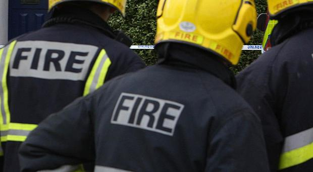 An elderly woman has died after a fire at a sheltered housing complex in west Belfast