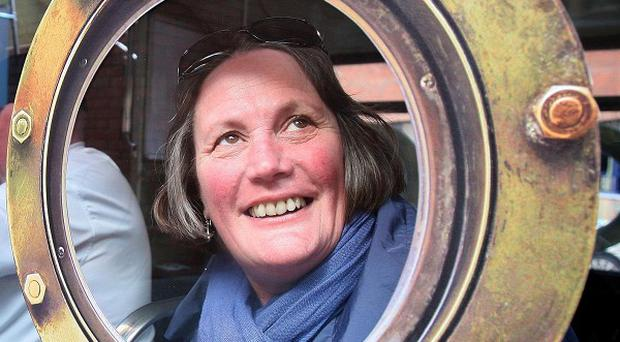 Kathryn Cordin from Perth, Western Australia, looks through a porthole on a Titanic bus tour of Belfast
