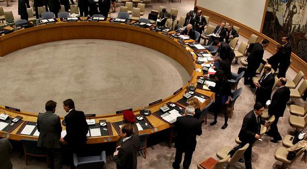Members of the United Nations Security Council gather at UN headquarters before voting to deploy military observers to Syria (AP)