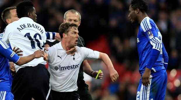 LONDON, ENGLAND - APRIL 15: Scott Parker of Tottenham Hotspur is restrained as he clashes with John Obi Mikel of Chelsea (R) during the FA Cup with Budweiser Semi Final match between Tottenham Hotspur and Chelsea at Wembley Stadium on April 15, 2012 in London, England. (Photo by Clive Rose/Getty Images)