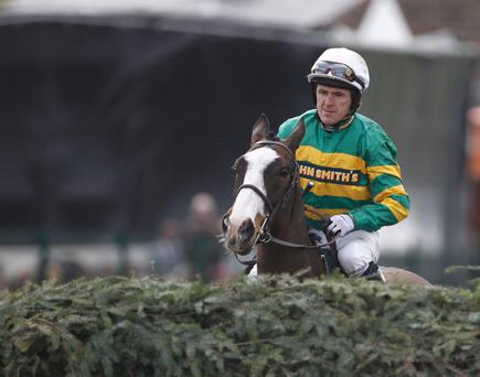 LIVERPOOL, ENGLAND - APRIL 14: Synchronised ridden by Tony McCoy surveys the first fence prior to 165th John Smith's Grand National Steeple Chase at Aintree Racecourse on April 14, 2011 in Liverpool, England. Jockey Tony McCoy was unseated by his mount in the moments leading up to the start of the race, which was won by Daryl Jacob riding Neptune Collonges. Synchronised had to be destroyed after falling at the sixth fence. (Photo by Christopher Furlong/Getty Images)