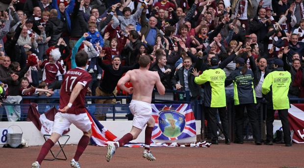 GLASGOW, SCOTLAND - APRIL 15: Craig Beattie of Hearts celebrates after scoring a penalty during The William Hill Scottish Cup Semi Final between Celtic and Hearts at Hampden Park on April 15, 2012 in Glasgow, Scotland. (Photo by Jeff J Mitchell/Getty Images)