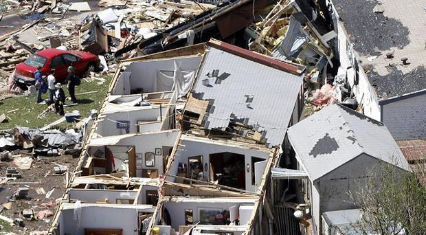 The damage in the Oaklawn neighborhood in Wichita, Kansas, caused by one of several tornadoes that hit the state (AP/Jeff Tuttle)