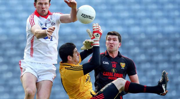 Cork's Alan O'Connor battles with Down duo Peter Turley and goalkeeper Brendan McVeigh
