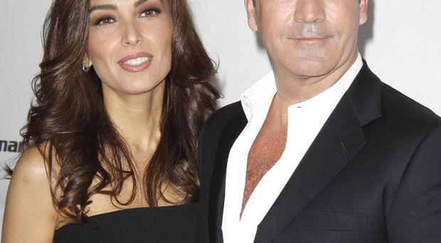 Simon Cowell is reportedly giving ex-fiancee Mezhgan Hussainy a house because he was a bad boyfriend