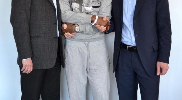 Dr Andrew Deaner (left), Fabrice Muamba (centre), and Dr Sam Mohiddin, as the Bolton Wanderers footballer has today been discharged from hospital