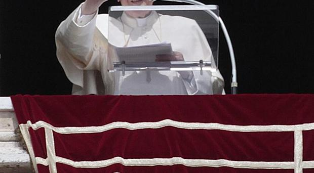 The Pope greets the faithful during the Regina Coeli prayer from St Peter's square at the Vatican (AP)