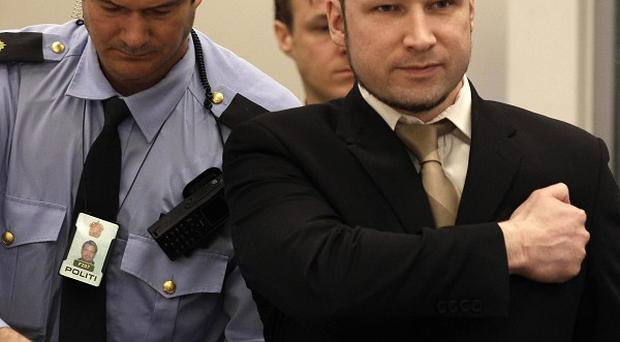 Anders Breivik arrives for his trial in Oslo, Norway (AP)
