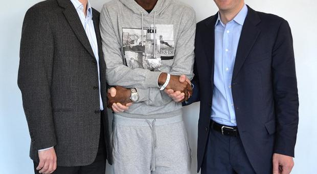 Fabrice Muamba, who has been discharged from hospital, shakes hands with Dr Andrew Deaner, left, and Dr Sam Mohiddin (Barts Health NHS Trust)