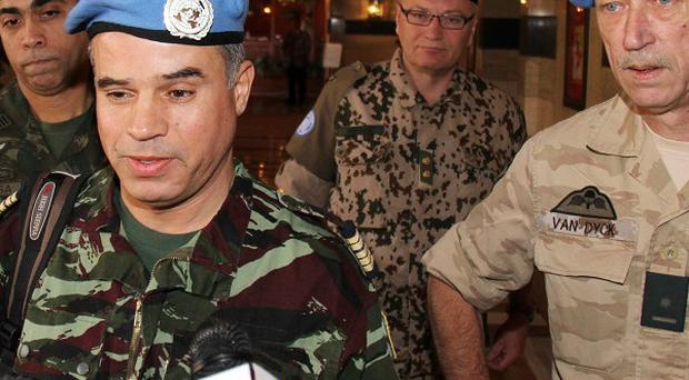 UN observers talk to journalists at the Sheraton Hotel in Damascus, Syria (AP)