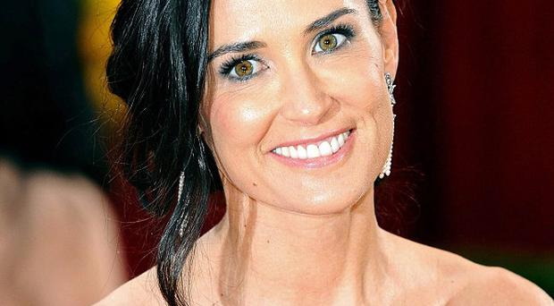 Demi Moore is back on Twitter posting a new self portrait
