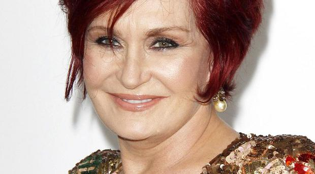 Sharon Osbourne is apparently upset at being mentioned in the unauthorised book about Simon Cowell