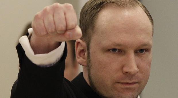 Anders Behring Breivik gives a salute as he enters the courtroom in Oslo (AP)