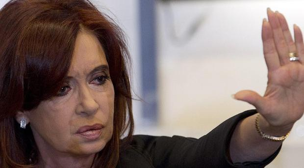 Argentina's president Cristina Fernandez has announced plans to seize control of Spanish-controlled energy firm YPF (AP)