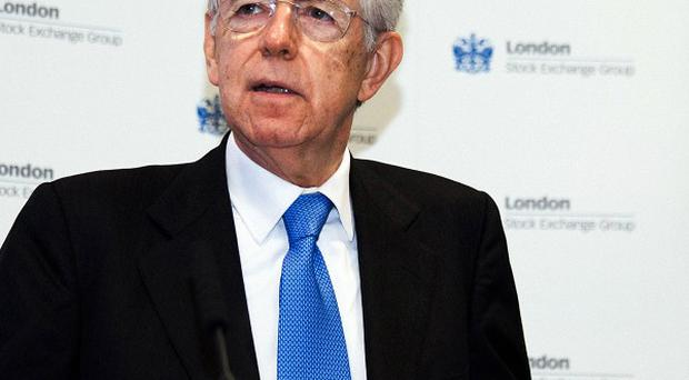 Italy's prime minister Mario Monti pledged to balance the country's budget by 2013