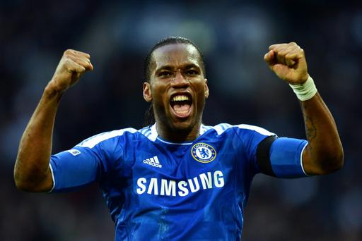 LONDON, ENGLAND - APRIL 15: Didier Drogba of Chelsea celebrates as Ramires scores their third goal during the FA Cup with Budweiser Semi Final match between Tottenham Hotspur and Chelsea at Wembley Stadium on April 15, 2012 in London, England. (Photo by Mike Hewitt/Getty Images)