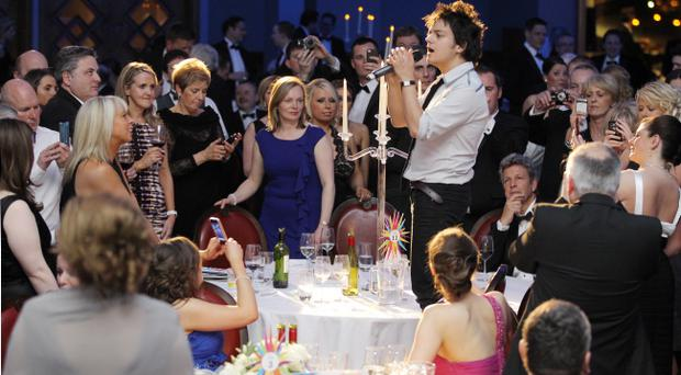 Singer Jamie Collum entertains guests at the gala dinner