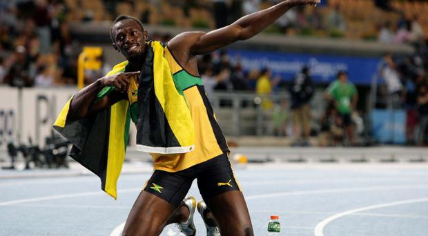 Triple Olympic champion Usain Bolt aims to 'amaze' the world at London 2012 by running 9.4 seconds for the 100m and 19 seconds for the 200m
