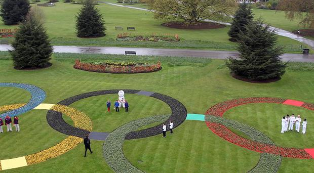 Giant Olympic rings made up of 25,000 flowers were unveiled at Kew Gardens