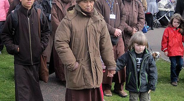 Buddhist Zen master and Vietnamese monk Thich Nhat Hanh offered advice for peace during a parade through Stormont