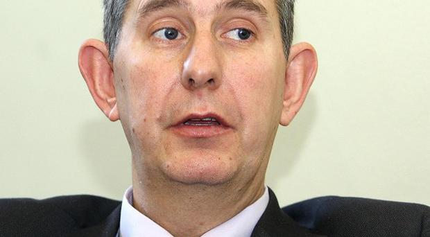 Health Minister Edwin Poots was wrong to call a fellow assembly member a 'village idiot' during a heated debate