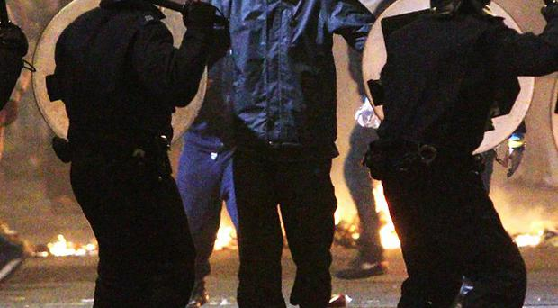 The police officer accused of racially abusing a man in the London riots is to appear in court next month