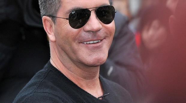 Simon Cowell's regime has been revealed in an unofficial biography