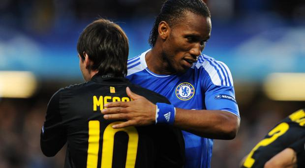 LONDON, ENGLAND - APRIL 18: Didier Drogba of Chelsea hugs Lionel Messi of Barcelona during the UEFA Champions League Semi Final first leg match between Chelsea and Barcelona at Stamford Bridge on April 18, 2012 in London, England. (Photo by Michael Regan/Getty Images)