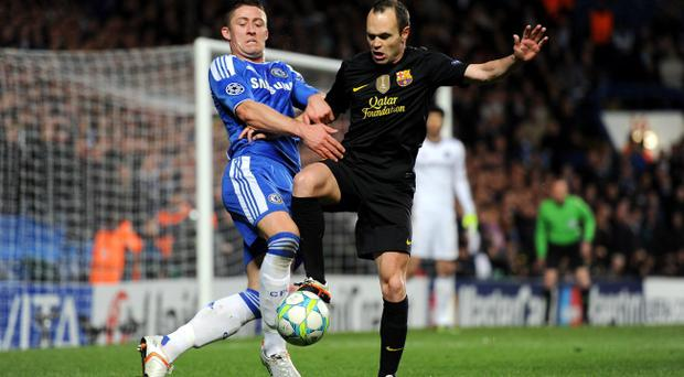 LONDON, ENGLAND - APRIL 18: Gary Cahill of Chelsea and Andres Iniesta of Barcelona compete for the ball during the UEFA Champions League Semi Final first leg match between Chelsea and Barcelona at Stamford Bridge on April 18, 2012 in London, England. (Photo by Michael Regan/Getty Images)