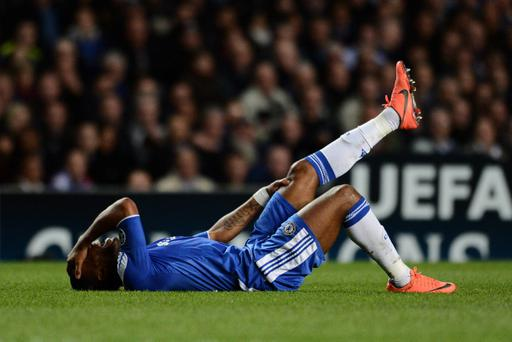 LONDON, ENGLAND - APRIL 18: Didier Drogba of Chelsea clutches his leg during the UEFA Champions League Semi Final first leg match between Chelsea and Barcelona at Stamford Bridge on April 18, 2012 in London, England. (Photo by Jasper Juinen/Getty Images)