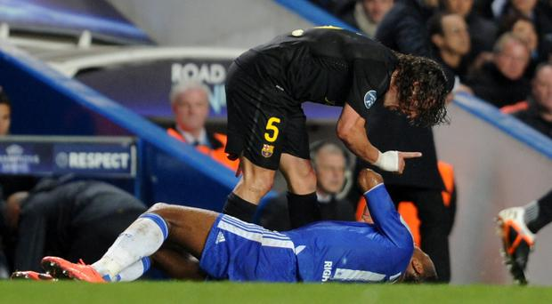 LONDON, ENGLAND - APRIL 18: Carles Puyol of Barcelona talks to Didier Drogba of Chelsea during the UEFA Champions League Semi Final first leg match between Chelsea and Barcelona at Stamford Bridge on April 18, 2012 in London, England. (Photo by Michael Regan/Getty Images)