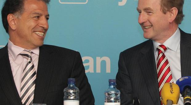 Enda Kenny shares a joke with Mylan executive chairman Robert J Coury at the job announcement in Dublin